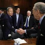 Senator Chuck Grassley (left) greeted Jeffrey Bewkes, chief executive of Time Warner, during a Senate Judiciary subcommittee hearing  Wednesday.  The subcom-mittee was gathering testimony regarding a proposed merger between Bewkes's firm and AT&T.